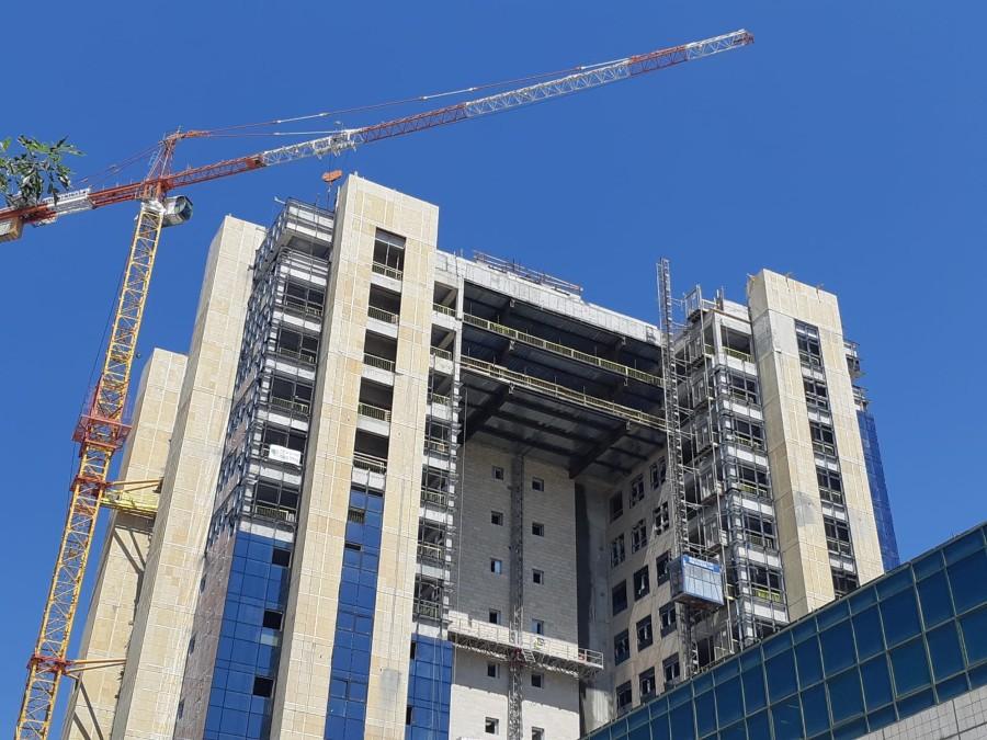 רד בינת ירושלים - חיפוי אבן עם דיבל, בורג בטון, עוגן חץ בורג עיין לעבודות בגובה
